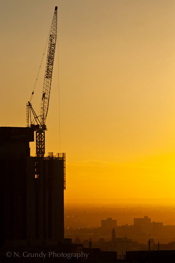 Sunset Crane by Construction Photographer in Ireland