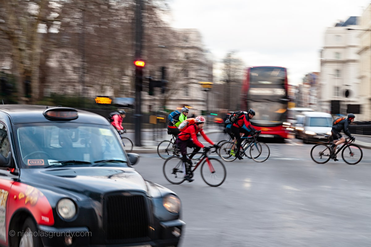 London Cyclists, Taxi and Double Decker Bus Photo